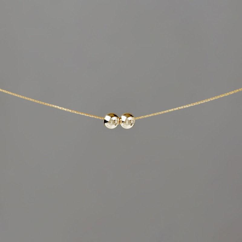 Medium Balls on Gold Stringing Chain