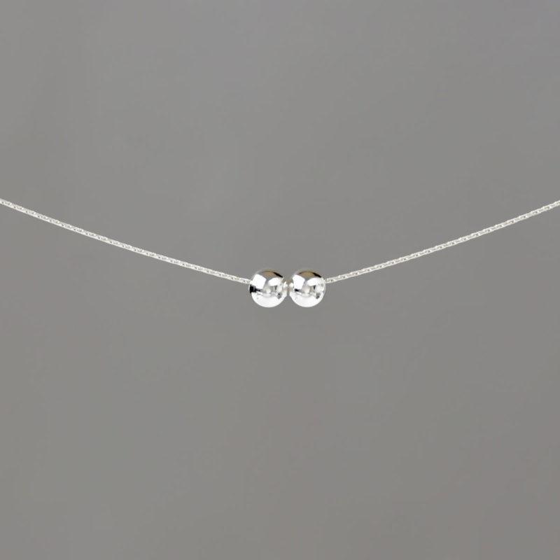 Medium Balls on Silver Stringing Chain