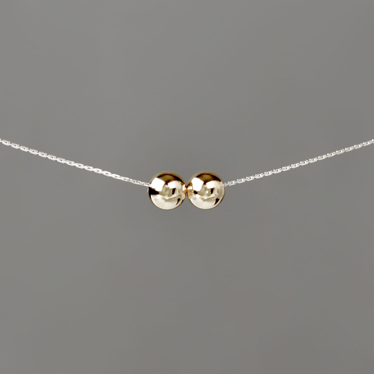 Large Gold Balls on Silver Stringing Chain
